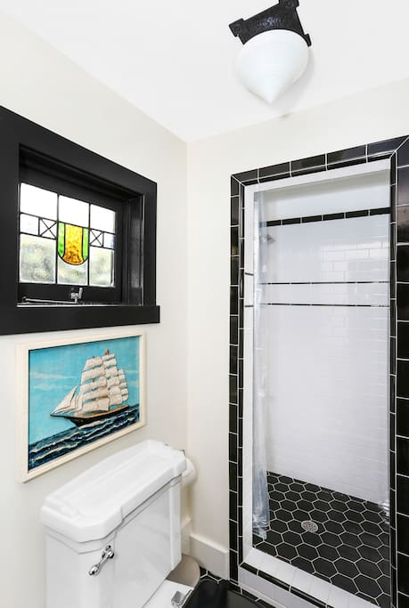 Vintage inspired bathroom has Waterworks fixtures.