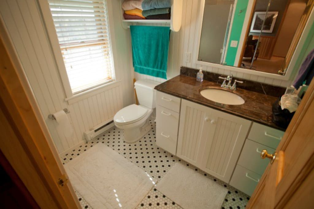 Shared Bathroom with 2-person tiled stall shower