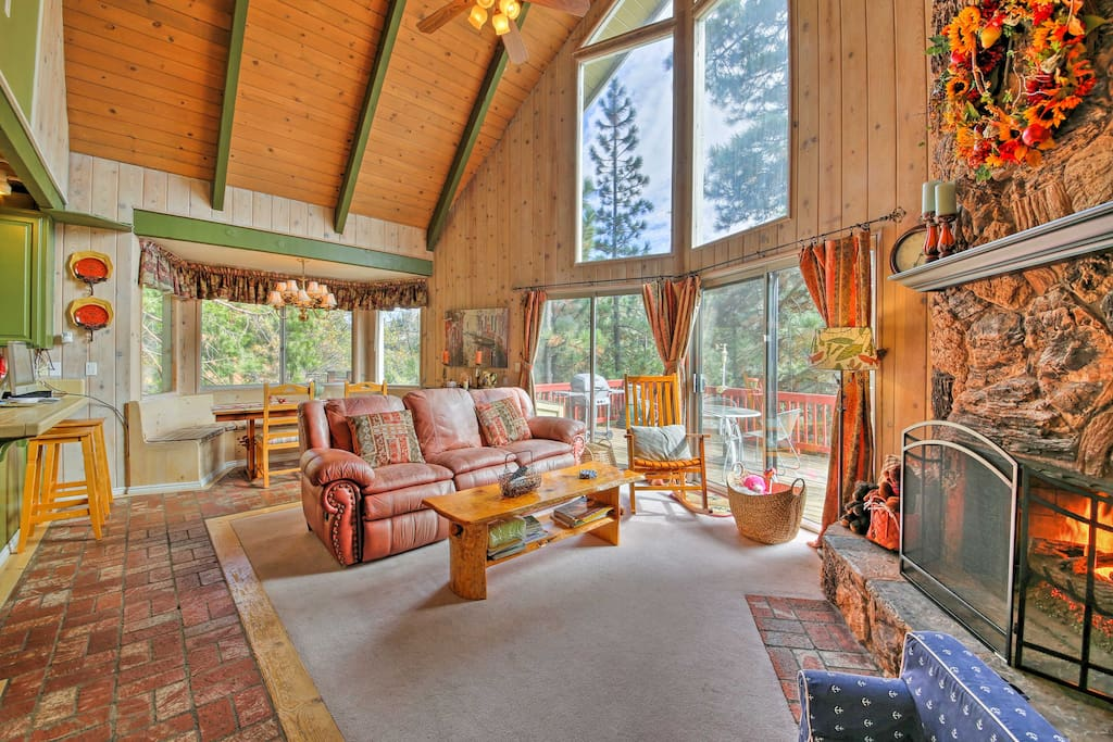 From the A-frame ceilings to the natural stone fireplace, this home showcases unique cabin charm around every corner!
