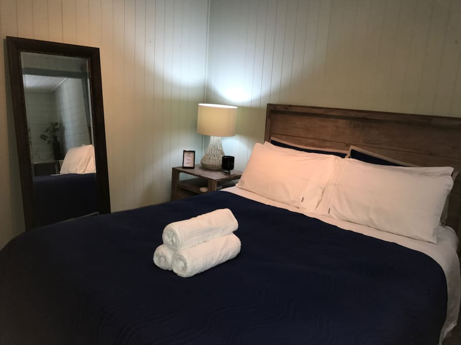Pillow top queen mattress complimented by luxurious Egyptian cotton linen, full air-conditioning, ioniser air purifier, personal fridge, tv and wifi.
