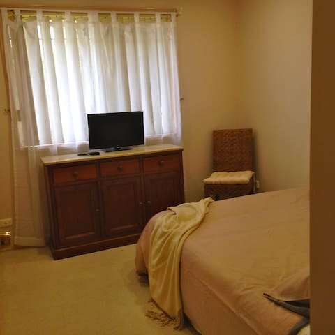 Comfortable, quiet room, with built in double robe, cabinet with drawers and small flat screen TV.