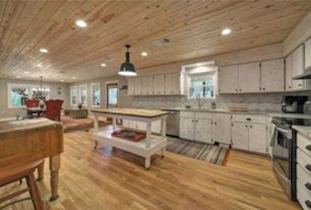 Large open concept kitchen and dinning room with all stainless steel appliances