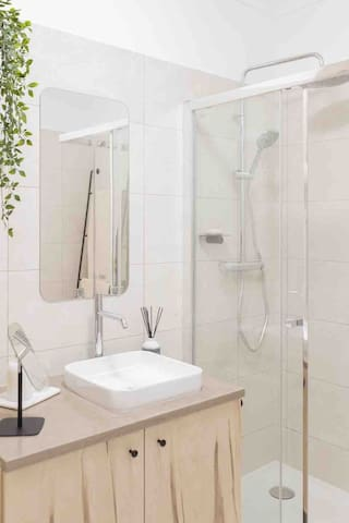 Bathroom with a shower. Baby bathtub available.