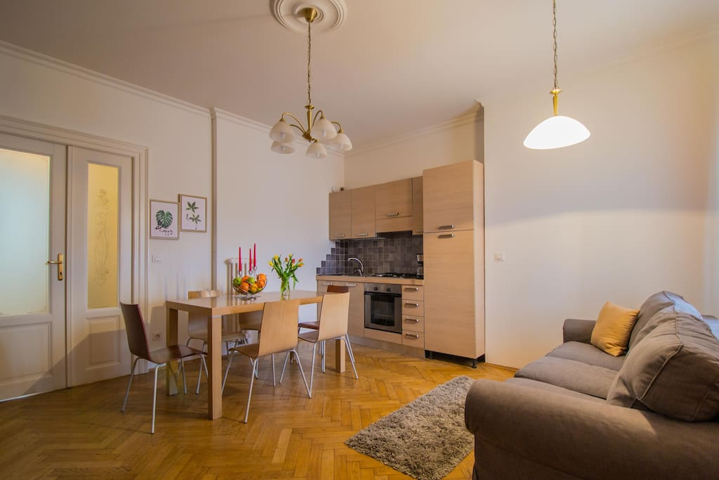Living room is connected to the kitchen area. There is big dining table for 6 people