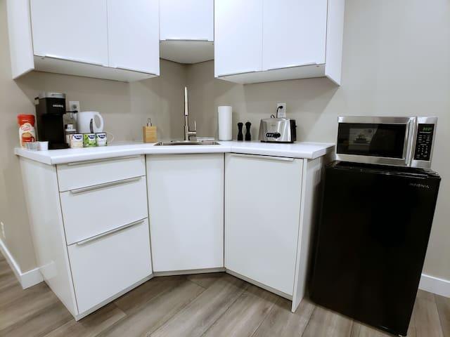 Equipt kitchen with utensils, cutlery, coffee, tea, sugar, salt pepper