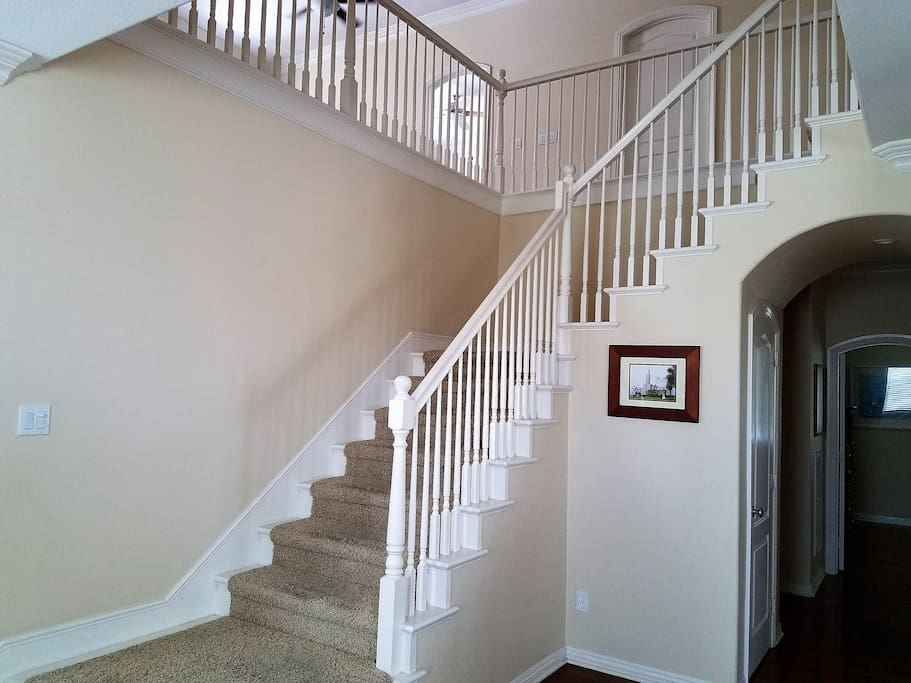 Stairs off entry way. You can see the doorway for bedroom one, at the front of the house.