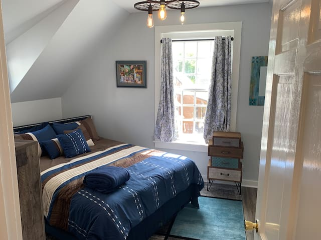 Bedroom, comfortable and inviting colors in a cozy but open space, with its own air conditioner unit, two closets, dresser and light and bright.