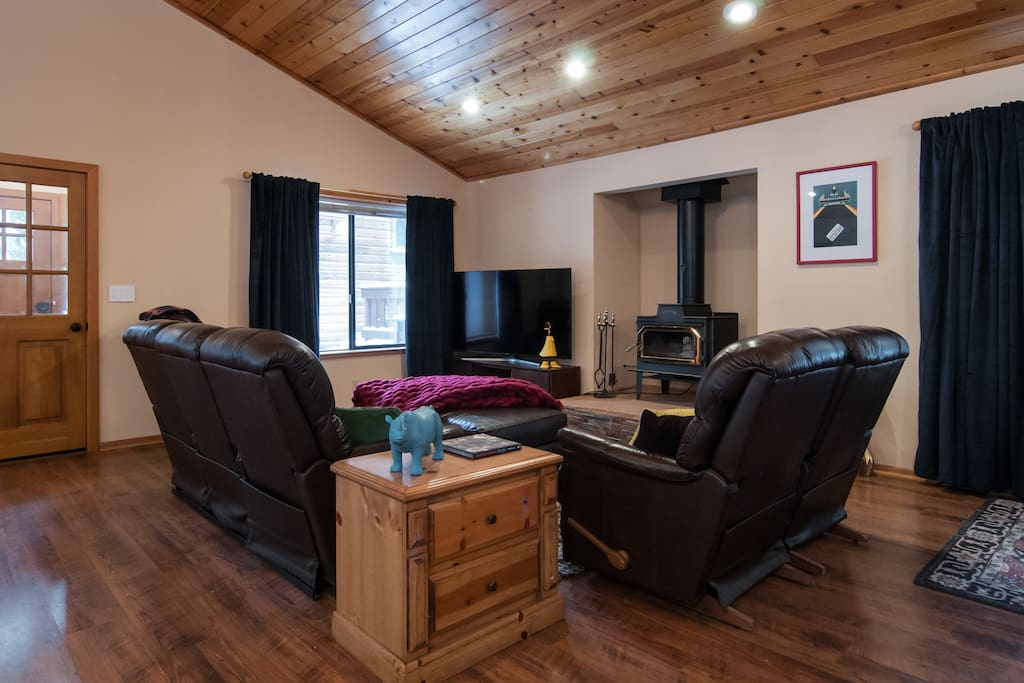 Comfortable, fireside living room with large flat screen TV