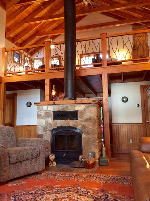 Open rafters, beautiful woodwork, and a gorgeous loft area make the common room a place you will never want to leave.
