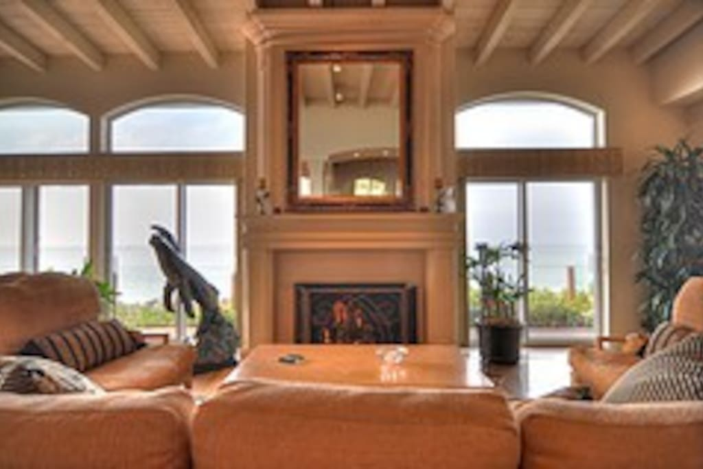 Living Room with Fireplace, and Sit Down Ocean Views