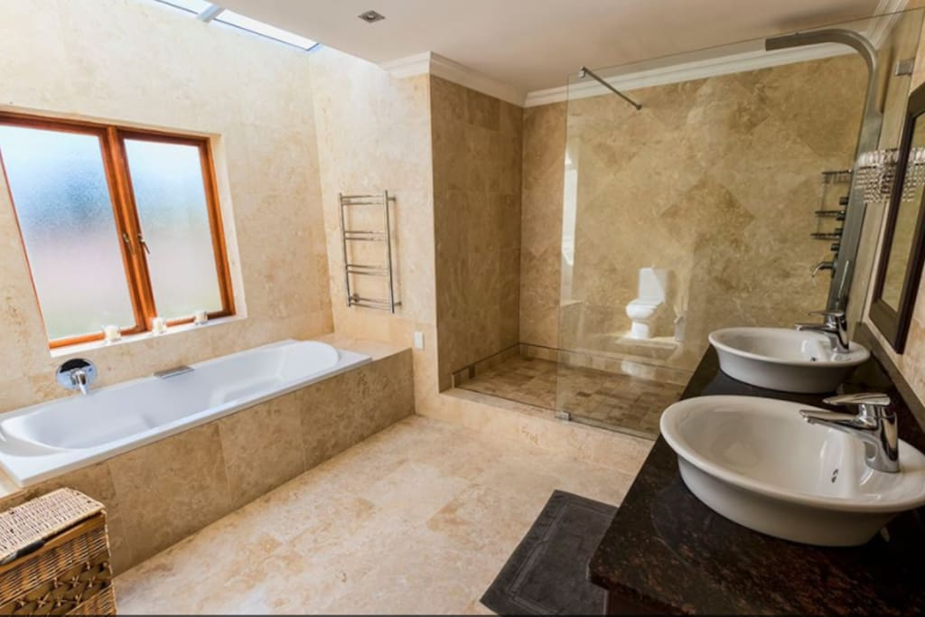 A truly luxurious bathroom with a skylight to the stars