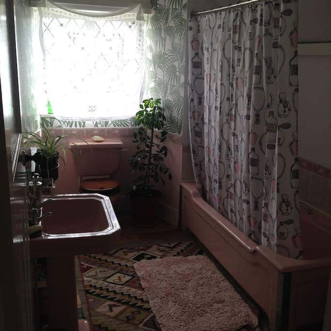 Private retro bathroom with powerful shower and toiletries provided.