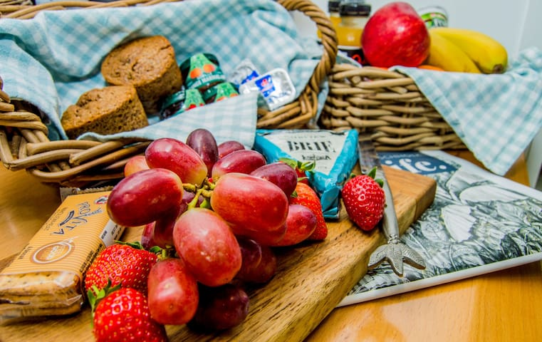 Complimentary welcome fruit basket and homemade muffins, jams, juice and yogurt for your first breakfast.  Also a cheese board and crackers