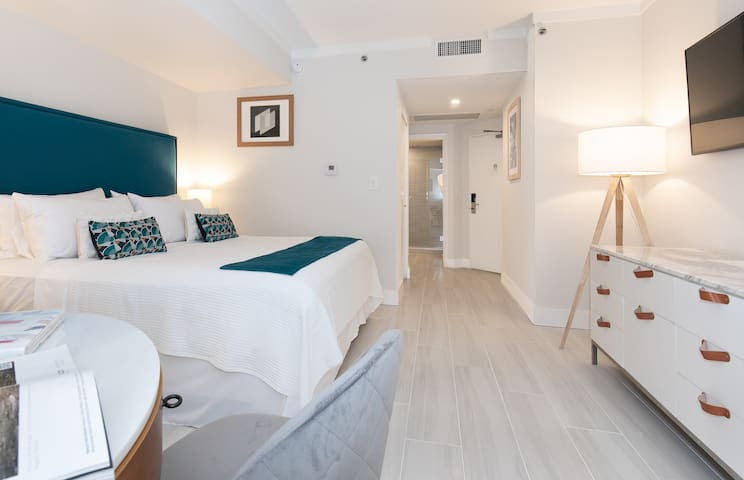 In the room: safe deposit box, washer and dryer, mini fridge...