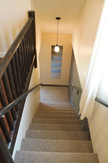 Stairs lead to the second story Overlook Suite.