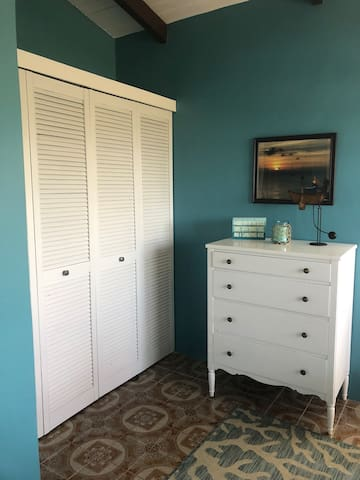 Empty closet and chest of drawers waiting for your clothes!