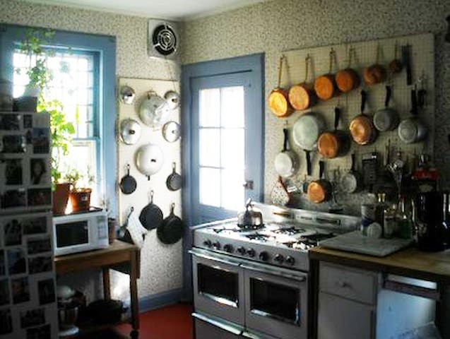 French kitchen with all essentials for fun cooking; extensive collection of cookbooks