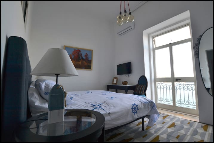 Bedroom 1, King size bed or two single bed options, view out onto the Grand Harbour.