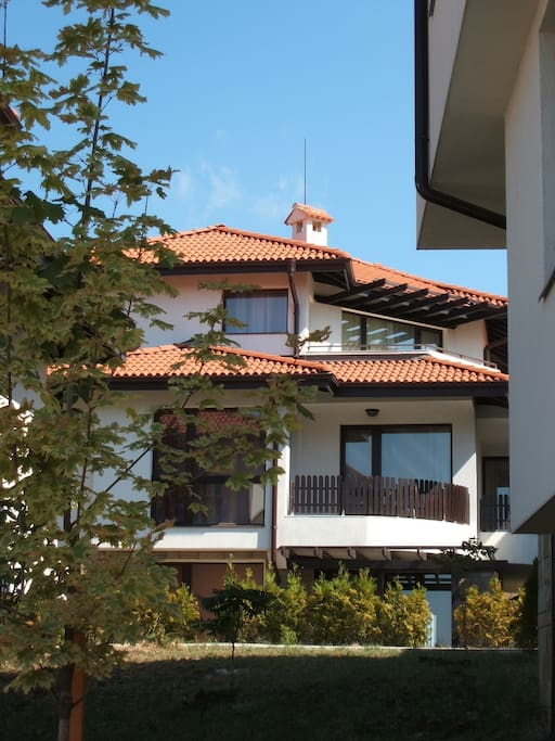 The apartment can be seen at the top of this villa.