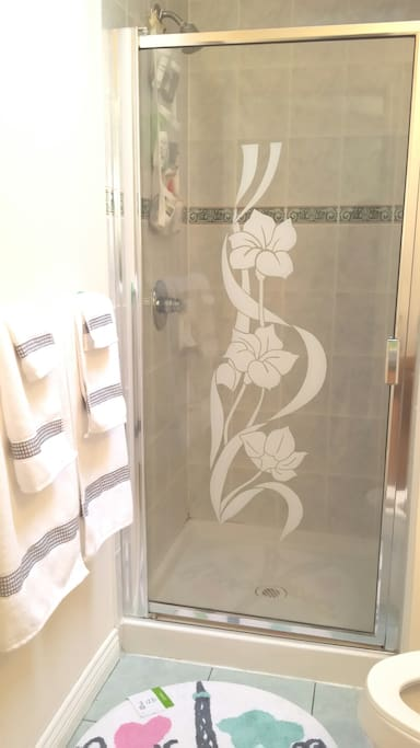 Your private bathroom with towel and shower gel