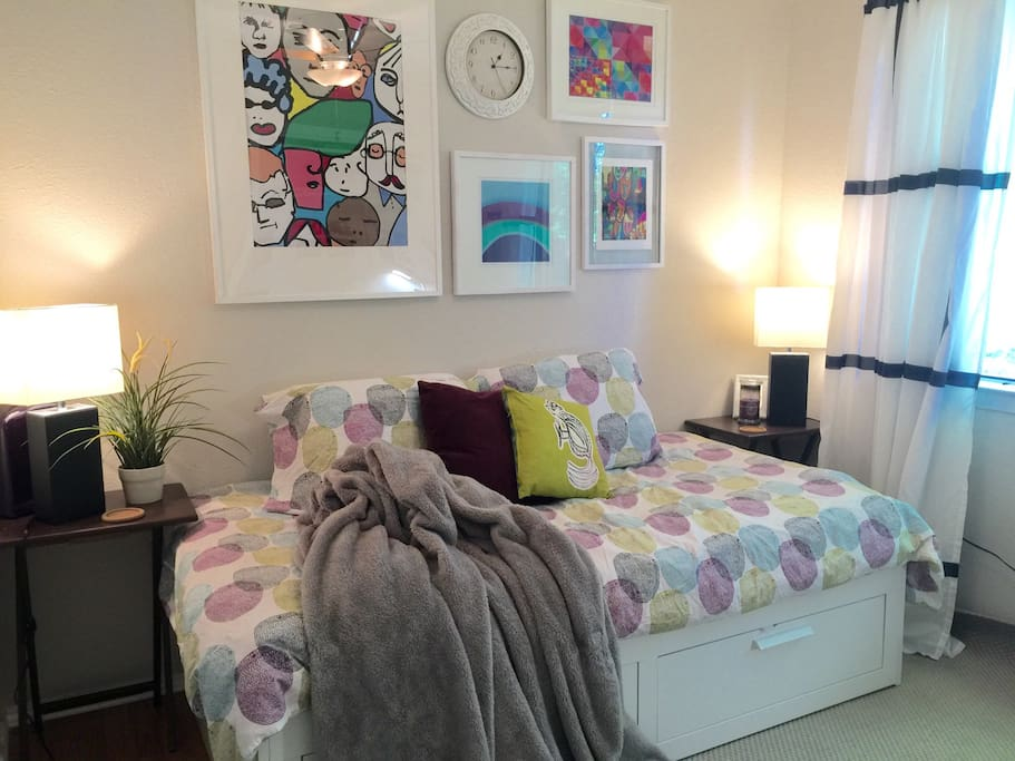 This room features a day bed that pulls out into a king-sized bed. Comes with fresh sheets, memory foam pillows, a plush blanket, a custom-built desk and a large window that bring plenty of natural light into the space.