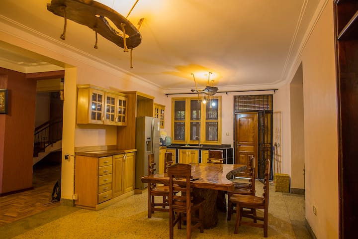 Fully furnished kitchen and dinning area where guests enjoy the meals