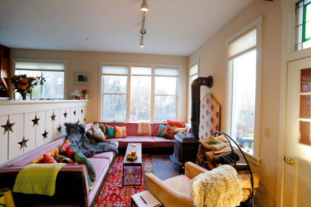 Comfy lower living area w wood stove and Moroccan couches