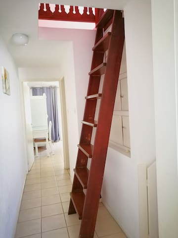 A wooden ladder that leads to the attic.