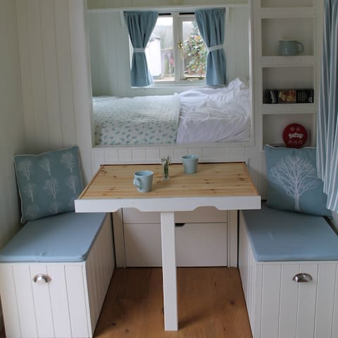 The pull-out table and benches in Bluebell