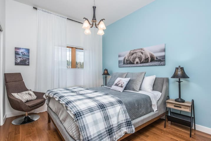 The Third bedroom also comes with a queen size bed with premium linens.  Go ahead and have a seat to enjoy some late night reading!