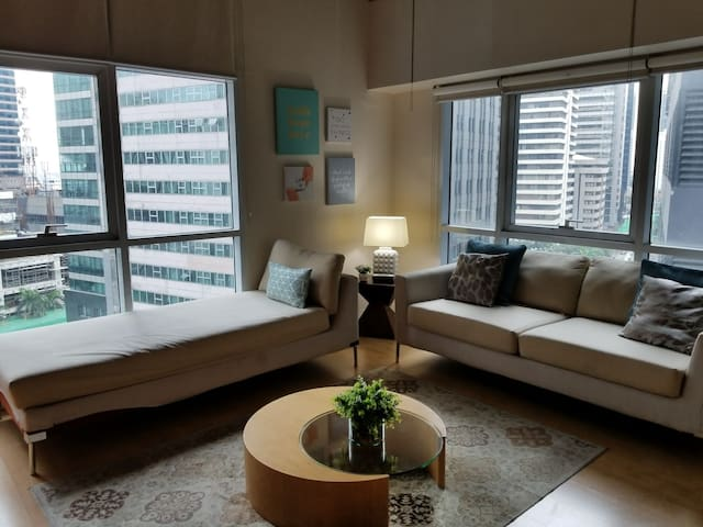 Furnished Corner Condo with Loft