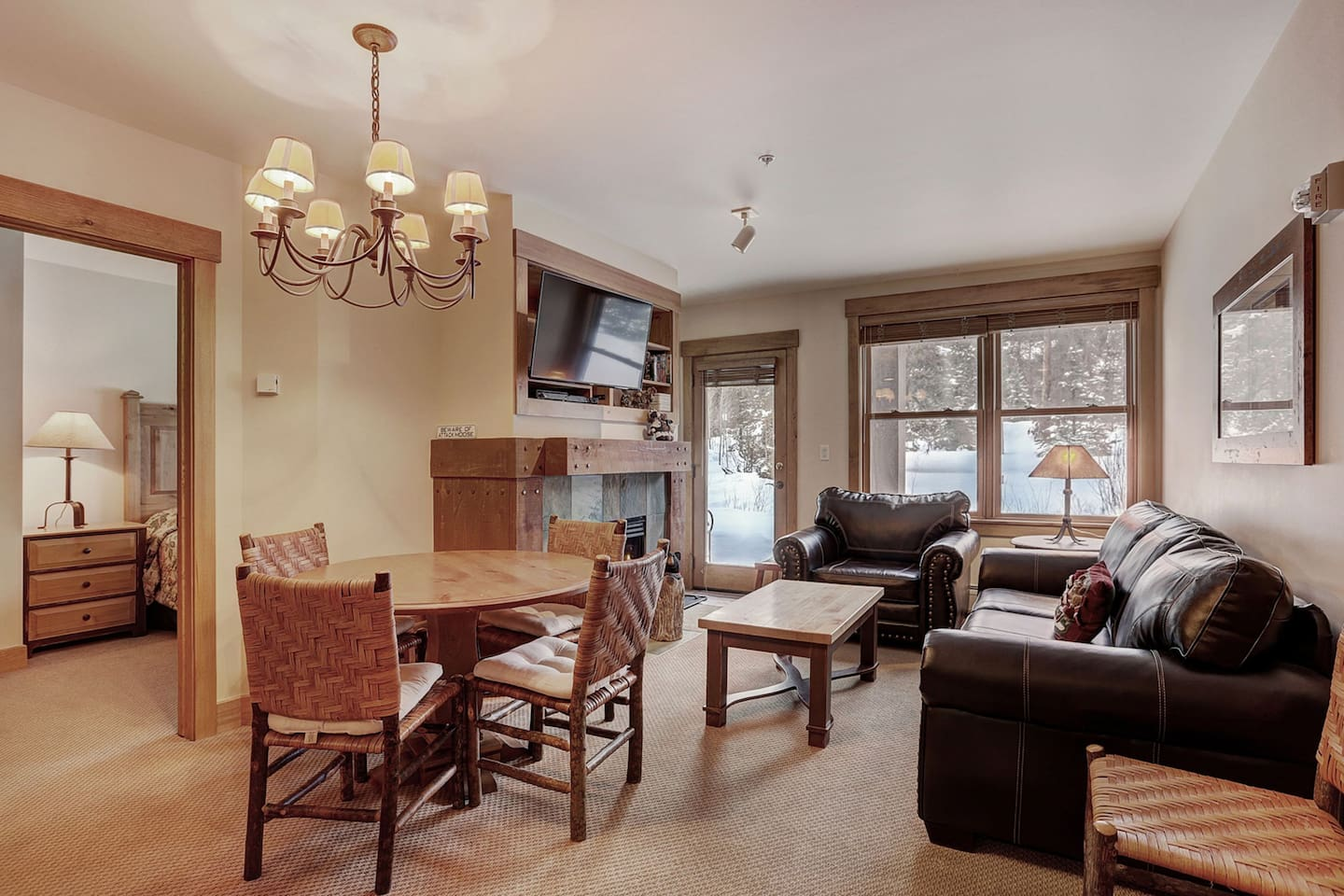 Perfect dining space for family meals and a nice living room with a TV and fireplace