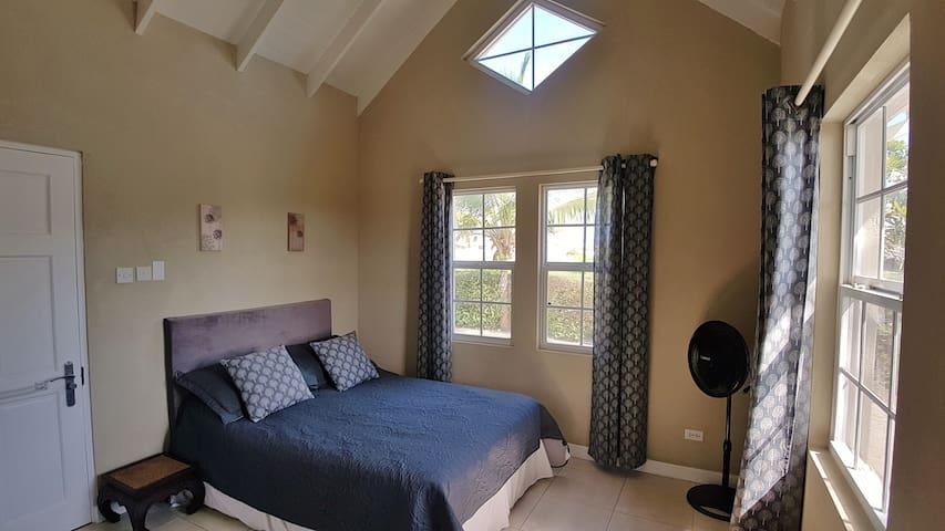 Master bedroom with air-con, fan, walk-in wardrobe and en suite