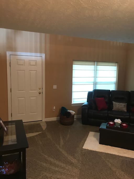 Living room area includes a leather reclining sofa, reading nook, and brand new board games. Monopoly, cards, uno, bingo, family feud, chess, Yahtzee.