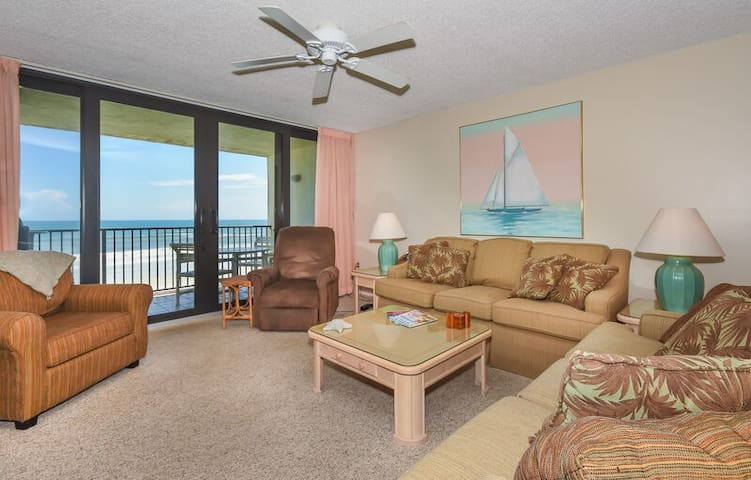 Oceanfront living room featuring a flat screen TV, DVD and recliner.