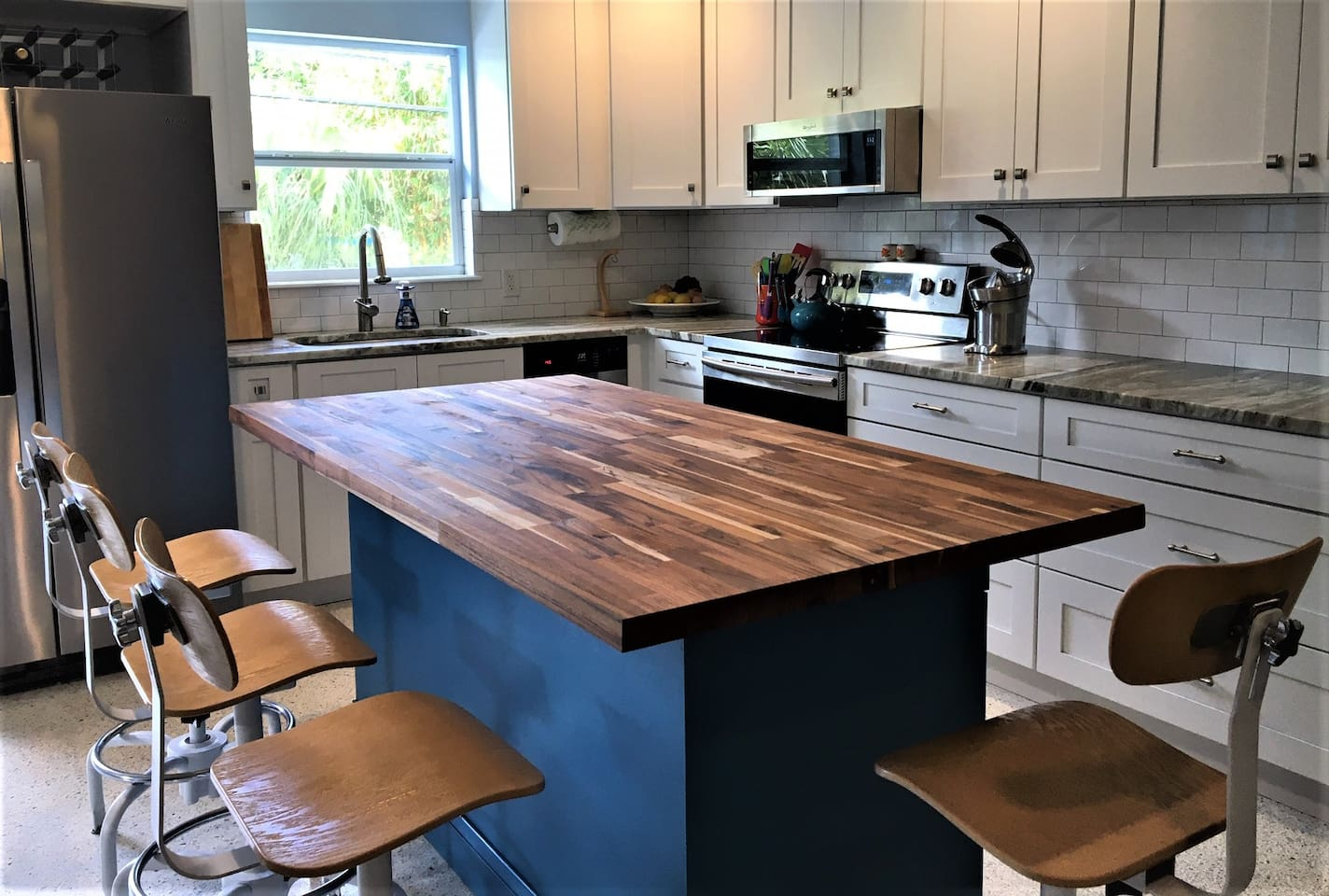 New kitchen November 2019.  Teak top island with granite on other counters.  Cabinets, sink, faucet and appliances are new. The serving dishes, silverware, cooking pots, pans and gadgets are all included.  Seating for four with room to do prep work