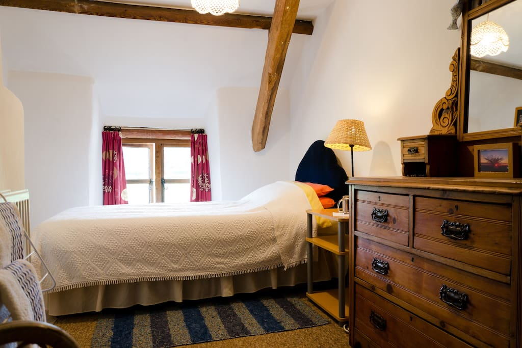 Single bed with views across the fields to the woods.
