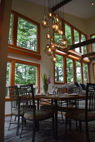 Dining room with floor to ceiling windows and spectacular view.