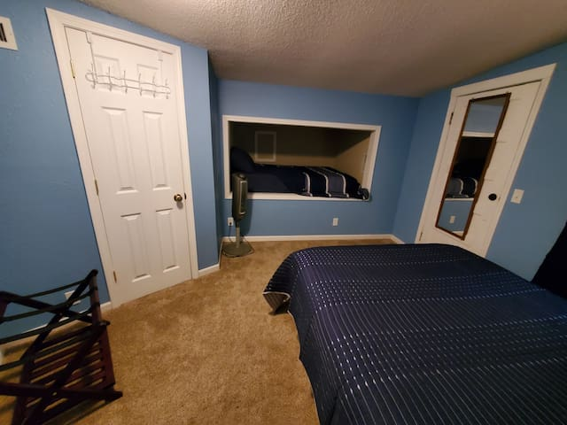 Bedroom (upstairs) features a queen bed, closet, luggage rack + a bonus full bed in a loft