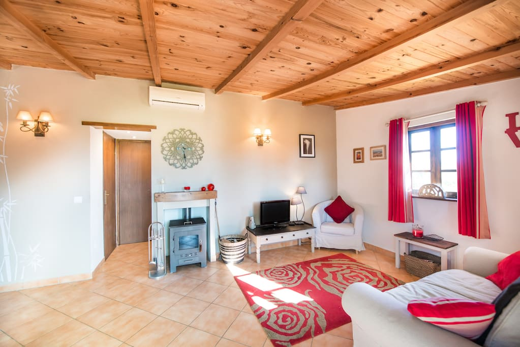 Cosy lounge, with wood burning stove for winter, air conditioning for summer