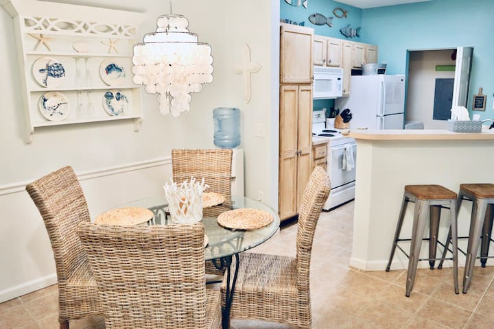 Enter kitchen through dining area. Bar stools for additional seating. Filter water station available.