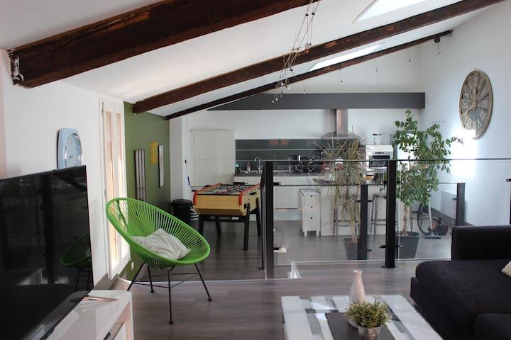 Loft 120m2 avec patio Centre Ville