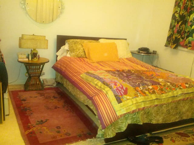 Roomy bedroom with queen sized bamboo organic mattress.  Tons of storage.