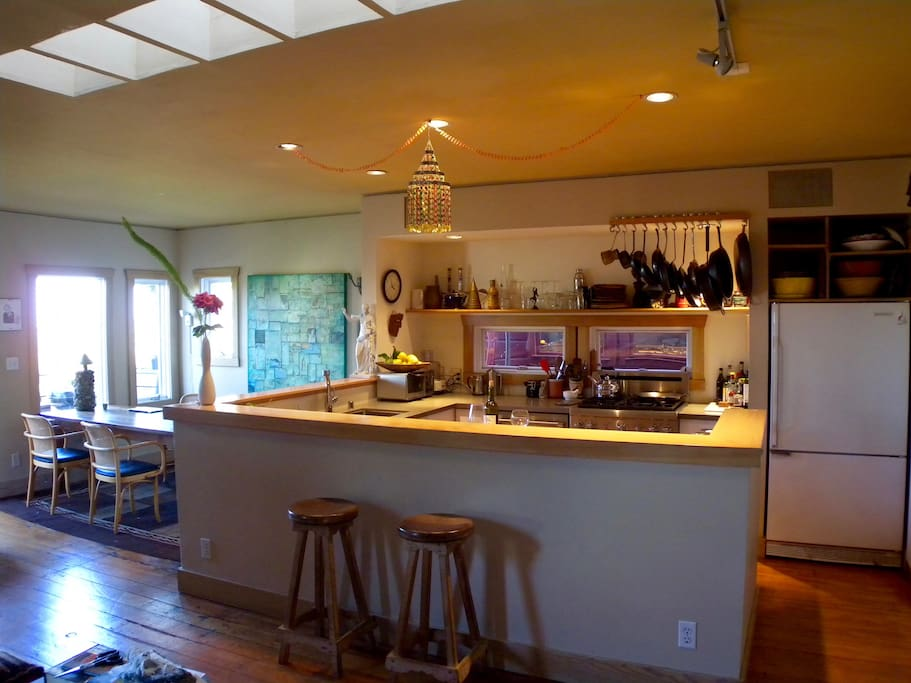 Flow from living room, to kitchen, dining, deck and garden
