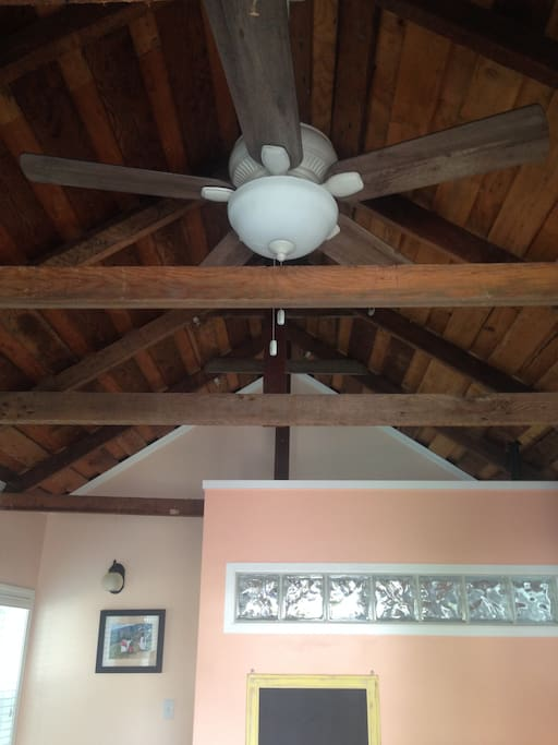 Vaulted beamed ceiling with ceiling fan