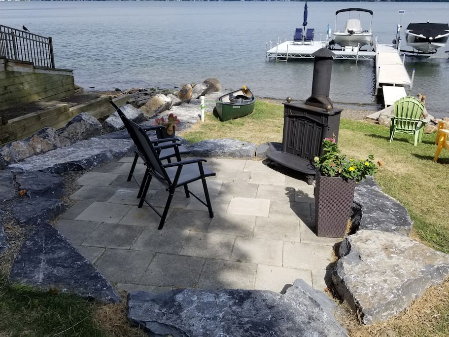 At the Lake-Lower patio with wood stove looking out toward the dock.  Supplies for making a fire are in the Lake Shack.  In the summer, you can watch live bands at the Switzerland Inn from here.   Lakefront closed from November 3 thru early spring.
