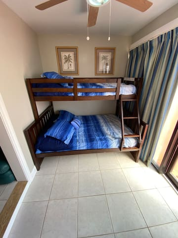 Hallway Bunk Beds- full bottom and twin top. Downstairs by back patio, open to the living room.(no door)