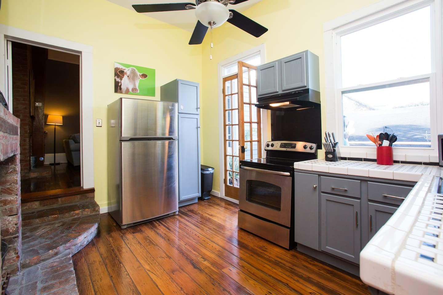 Kitchen with a full oven, refrigerator & dishwasher