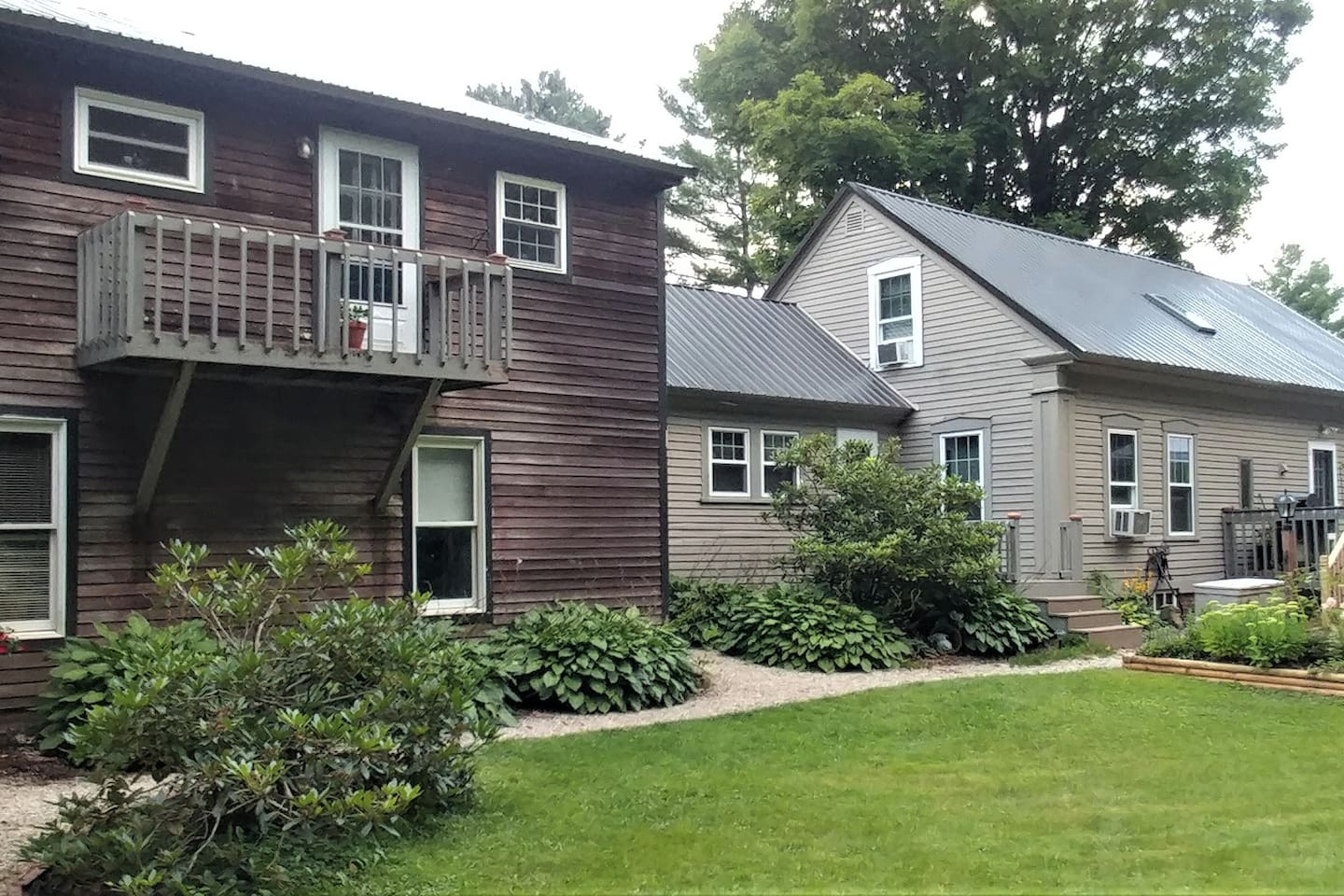The main house, circa 1820, sits on 3/4 of an acre, surrounded by trees for privacy.  A smaller living space connects the main house to the old barn,  which was also a boxing ring! The upper floor, newly updated, is your private vacation retreat!