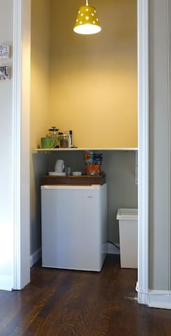 Kitchenette includes mini fridge, microwave, and electric kettle